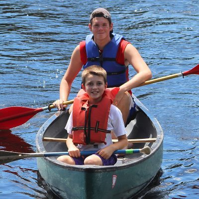 boy-with-counselor-in-boat